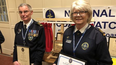 Steve Atkins, deputy station manager, and Linda Lawrence, station manager, receiving their ten-year