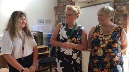 A pupil welcomes Sheringham town mayor Madeline Ashcroft, right, and deputy mayor Liz Withington. Pi