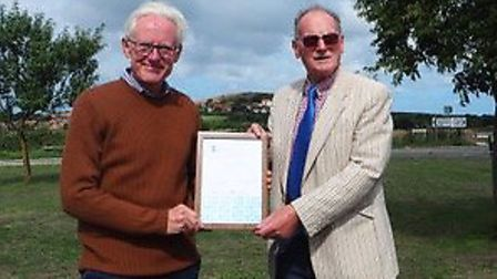North Norfolk MP Norman Lamb, left, presented the award certificate to Beeston Regis vice-chairman R