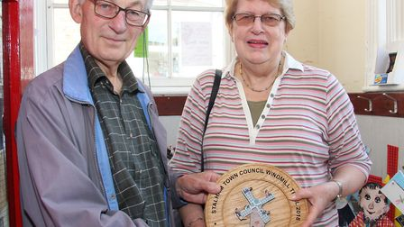 Councillor Duncan Edmonds presents plaque to Sonia Thomas, a prize for taking part in the Stalham Wi