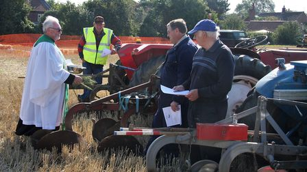 Revd Barry Furness doing the honours at a Blessing of the Ploughs event in Honing, near North Walsha