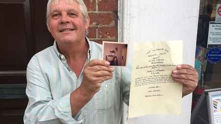 Roy Starling, who is organising the reunion, holding a photo of himself from the old days. Picture: