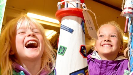 Georgia and Isla Ellis enjoy looking at the decorated lighthouses in Cromer.Picture: Nick Butcher