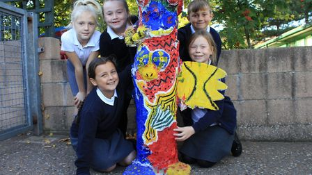 Sheringham Primary pupils with a totem pole made as part of a sculpture trail around the school.Phot