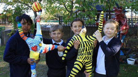 Sheringham Primary pupils with a papier mache figures made as part of a sculpture trail around the s