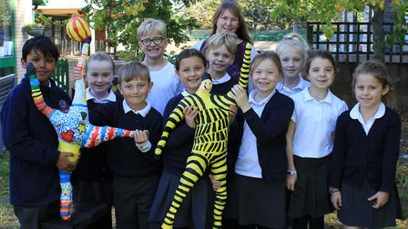 Sheringham Primary pupils and teacher Simone Stoppani with a papier mache figures made as part of a
