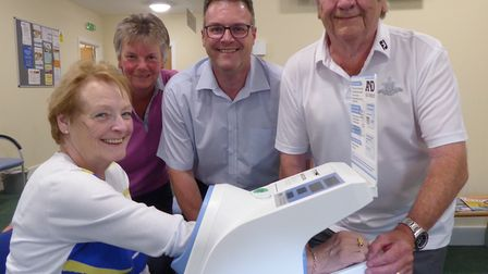 Cromer Patient Participation Group member Shay Nash tries to the new blood pressure monitor watched