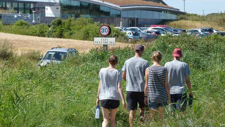 A group of walkers move towards the vistors centre at the Cley Marshes. Picture: STEVE COX
