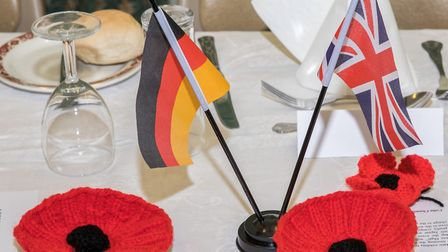 Twin towns remember war dead. Table decoration with poppies and flags. Pictures: Greg Garfoot