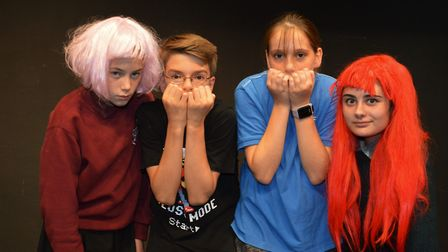 Witches Rosa Cormack (left) and Keira Painter (right) scare youngsters Caius Law and Zoe McKean who