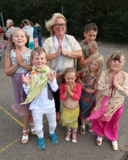 Happisburgh Primary School head Kate Mejri with pupils at the school's Bollywood dance workshop day.
