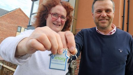 Victory Housing Trust development director Mark Burghall hands over the keys to Jane Craske. Picture