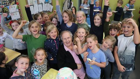 Elizabeth Bacon surrounded by pupils at Aldborough Primary School, where she has worked for the past
