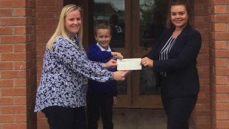 Gemma Watling, assistant head at Caister Junior School, receiving the cheque from Persimmon Homes An