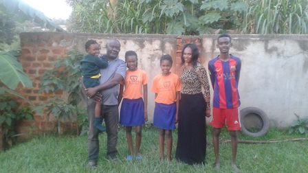 Ugandan pastor Steve Musisi with his family. Picture: SUPPLIED BY LIGHTHOUSE