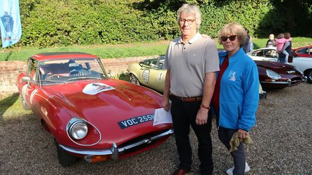 Jonathan and Nicolette Cole with their 1970 E-Type Jaguar on the Round Britain Coastal Drive ready t
