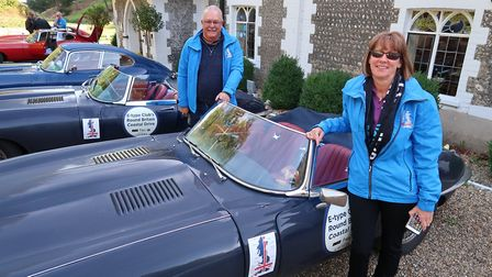 Rachel and Paul Pitfield with their 1965 Series 1 E-Type Jaguar roadster on the Round Britain Coasta