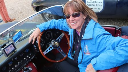 Rachel Pitfield in a 1965 Series 1 E-Type Jaguar roadster on the Round Britain Coastal Drive ready t