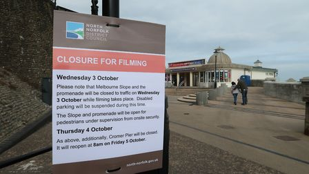 A sign in front of Cromer Pier saying Melbourne Slope and the town's promenade will be closed to tra
