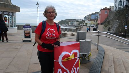 Hilary Cox shortly before heading off on the 250-mile Hike for Hearts from Cromer Pier. Picture: STU