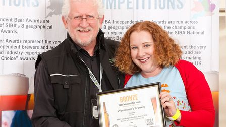 Dave Parish presents Judi-mae Alderton, Head of Marketing for Woodforde's, with the award. Pictures: