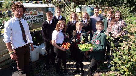 Reepham High School and College teacher Matthew Willer with students at the Allotment Project. Pictu