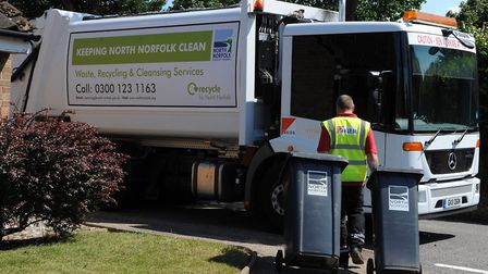 File photo of a worker collecting bins in north Norfolk. The region's district council has sent out