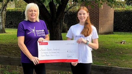 Gina Weston, left, and Jasmine Pearce at the cheque presentation. Picture: Meningitis Research Found