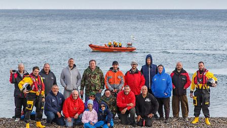 Sheringham lifeboat crew members Paul Pretty (left) and Jez Brown with members of the Coast 2 Coast