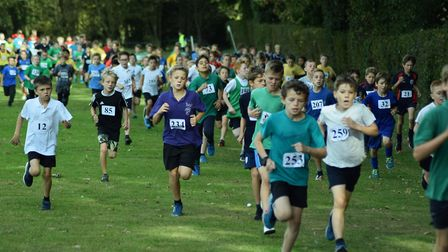 Record numbers of Norfolk pupils competed yesterday in an annual cross-country event at Gresham''s S