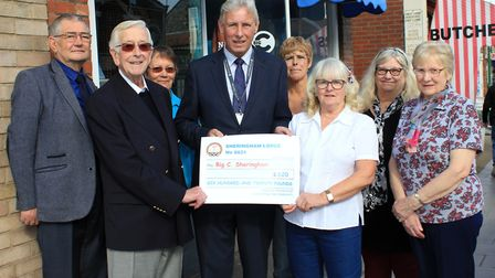 Sheringham Masonic lodge worshipful master Peter Macdonald (front left) and Maggie Smee presenting a