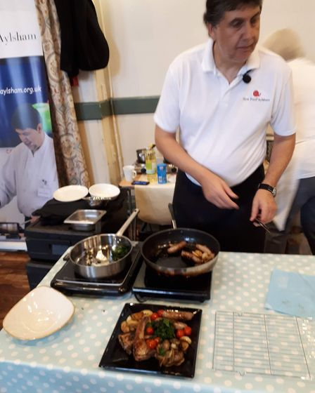 Local chef Derrol Waller demonstrated his cookery skills on at the festival showcase on Saturday, Oc