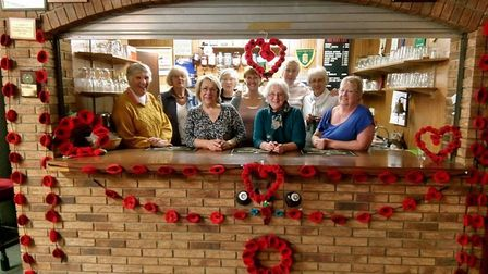 North Walsham Bowls and Snooker Club members at the bar, decorated with poppies. Picture: COURTESY T
