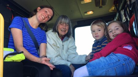 From L-R, in the back of a fire engine, Annabel Goodall, Judy Goodall, Ernest Goodall, two, and Hett