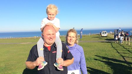 Dad Chris Hele, Isla Hele, four, and mum Sam Hele took part in the community fun-run in Cromer. Pict