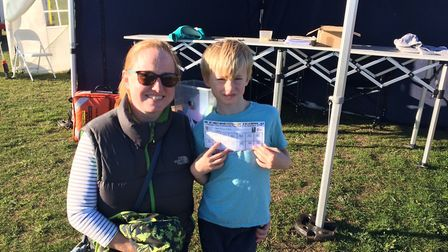 Community fun-run in Cromer. Miranda Roberts with son Louis, who completed three laps of the track.