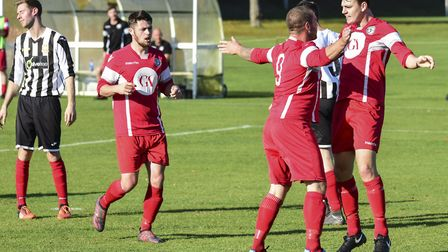 Sheringham celebrate their winning goal at Acle on Saturday Picture: Robert Walkley