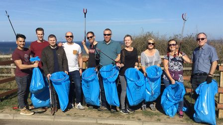 Mars Wrigley Confectionery employees out on a beach clean in north Norfolk. Picture: MARS