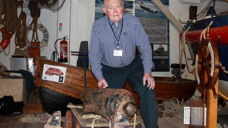 Sheringham Museum director Tony Sadler with the rescue cannon donated by the residents of the town's