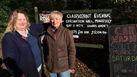 Margaret Brett, left, and Denise McKeough with one of the remaining signs near Mundesley. Picture: S