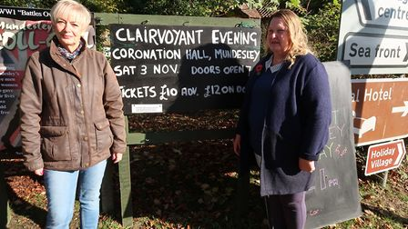 Denise McKeough, left, and Margaret Brett, with one of the remaining signs near Mundesley. Picture: