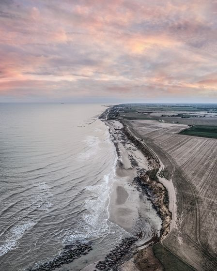 The north Norfolk coast at dawn, near Happisburgh Lighthouse. Picture: THEO SOUTHEE/ABOVE AIR MEDIA