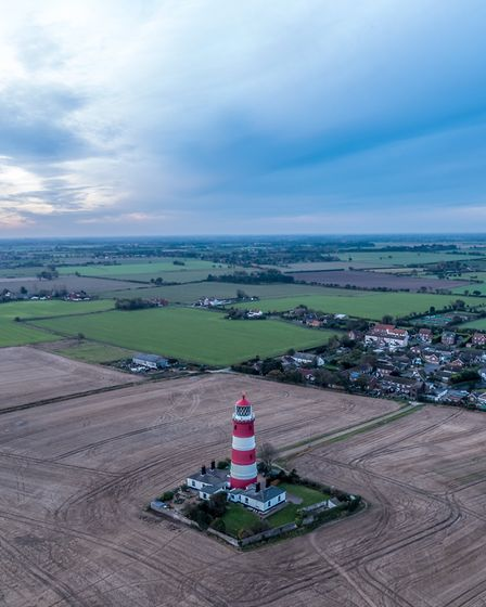 Happisburgh Lighthouse at dawn. Picture: THEO SOUTHEE/ABOVE AIR MEDIA