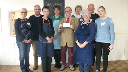 Branch member David Russell presented a cheque of £500 f to the volunteers. at the Community Cafe in