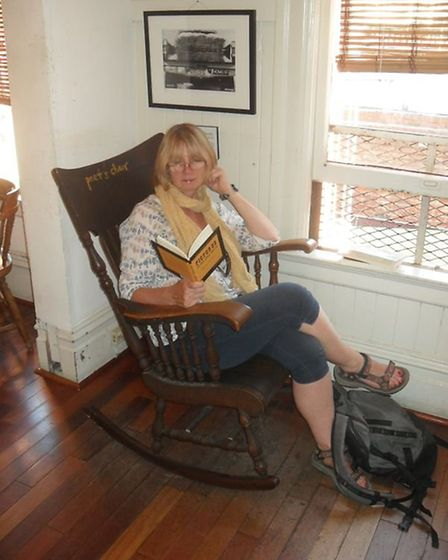 Sue Burge in the Poet's Chair at City Lights bookshop in San Francisco. Photo: Sue Burge