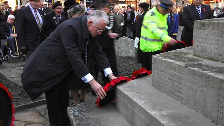 Cromer Remembrance Day parade and service. Norman Lamb MP lays a wreath.; PHOTO: ANTONY KELLY