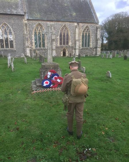 A re-enactor lays a wreath at one of the churches of Poppyland Benefice in north Norfolk on Remembra