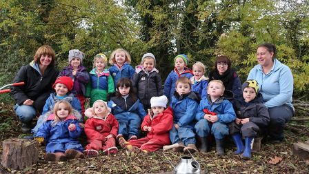 Youngsters enjoying Worstead Pre-school's forest school with staff members Paula Self, Nicola Collin