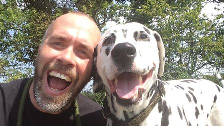 Jonathan Pettus and his dog Riggs. Picture: COURTESY OF JONATHAN PETTUS
