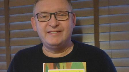Dominic Zenden with his new book, Angels on our side. Picture: SUPPLIED BY ALISON ZENDEN
